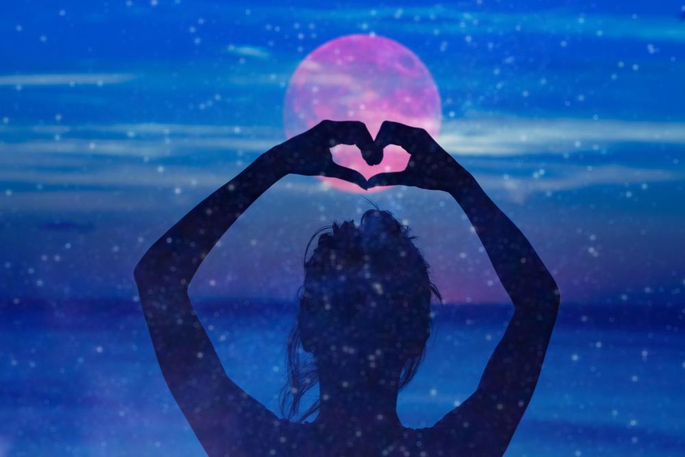 Girl heart symbol beach